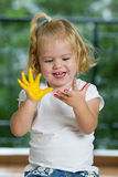 Little girl with hands painted Stock Photos