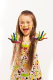 Little girl with hands painted in colorful paint Stock Images