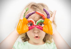 Little girl hands painted. In colorful paints stock images