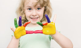 Little girl hands painted in colorful paints Royalty Free Stock Image