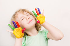 Little girl hands painted in colorful paints Royalty Free Stock Photography