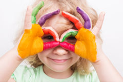 Little girl hands painted in colorful paints Royalty Free Stock Images