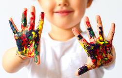 Little girl hands painted in colorful paints isolated. Little girl hands painted in colorful paints royalty free stock photography