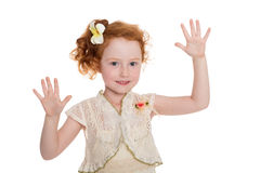 Little girl with hands raised Stock Photos