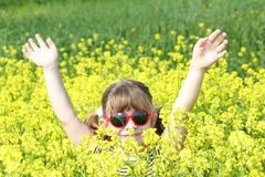 Little girl with hands up Stock Photography