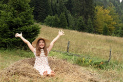 Little girl with hands up enjoys nature Royalty Free Stock Images