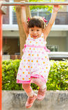 Little girl hanging on a bar Royalty Free Stock Image