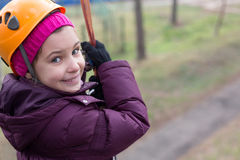 Little girl hanging on a rope Royalty Free Stock Photo