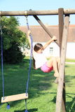 Little kid - girl hanging on rope and contruction Stock Image