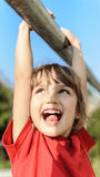 Little girl hanging from steel pipe Stock Image