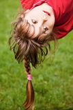 Little girl hanging upside-down Stock Photos