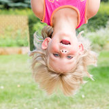 Little Girl Hanging Upsidedown Royalty Free Stock Photos