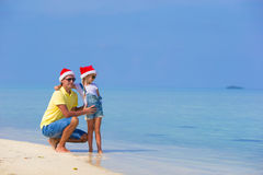 Little girl and happy dad in Santa Hat during Royalty Free Stock Photography