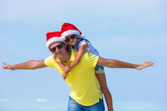 Little girl and happy dad in Santa Hat during Stock Images