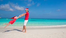 Little girl and happy dad in Santa Hat have fun at. Young father and adorable little daughter in Christmas Hat Royalty Free Stock Photos