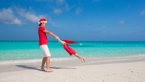 Little girl and happy dad in Santa Hat have fun at Stock Image