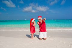 Little girl and happy dad in Santa Hat have fun at. Young father and adorable little daughter in Christmas Hat Stock Images