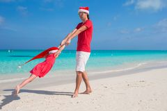 Little girl and happy dad in Santa Hat have fun at Royalty Free Stock Images