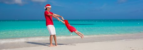 Little girl and happy dad in Santa Hat have fun at Royalty Free Stock Photography