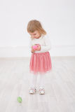 Little girl is happy Easter. Little Girl with Easter eggs in their hands smiling Royalty Free Stock Photo