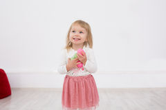 Little girl is happy Easter. Little Girl with Easter eggs in their hands smiling Stock Photos