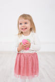Little girl is happy Easter. Little Girl with Easter eggs in their hands smiling Royalty Free Stock Images