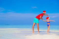 Little girl and happy father in Santa Hat during Royalty Free Stock Photos