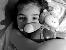 Little girl. Happy little girl hugging her teddy bear Royalty Free Stock Photos