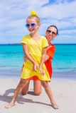Little girl and happy mom during tropical beach Royalty Free Stock Image