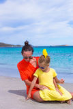 Little girl and happy mom during tropical beach Stock Photography