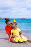 Little girl and happy mom during tropical beach Stock Image