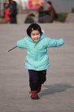 Little girl happy running Royalty Free Stock Photos