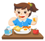 A Little girl happy to eat breakfast in the morning. Royalty Free Stock Photos