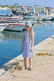 Little girl in the harbor in striped dress Royalty Free Stock Image