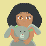 Little girl with the hare. Shy girl hiding behind a toy rabbit Stock Image