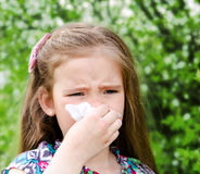 Little girl has allergy to spring blossoming Stock Photos