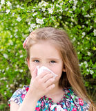 Little girl has allergy to spring blossoming Stock Photo