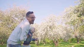 Little girl has a blast playing around on her dads shoulders stock video footage