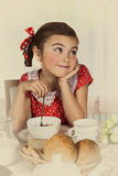 Little girl has breakfast at home Royalty Free Stock Images