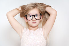 Little girl has fun. While making faces Royalty Free Stock Images