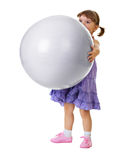 Little girl has a huge ball on white background Royalty Free Stock Images