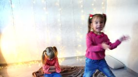 Little girl has offended friend, child crying and sad. Pretty little girl offended friend, child crying and sad. Kid obused on background of christmas lights stock video footage