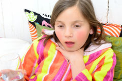 A little girl has a sore throat Royalty Free Stock Photo