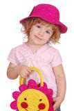 Little girl with hat and bag Royalty Free Stock Image