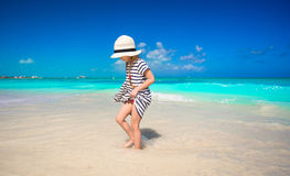Little girl in hat at beach during caribbean Stock Photo