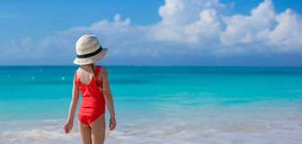 Little girl in hat at beach during caribbean Stock Image