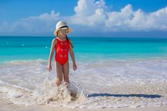 Little girl in hat at beach during caribbean Royalty Free Stock Photos