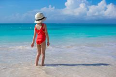 Little girl in hat at beach during caribbean Stock Photography