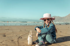 Little girl in a hat on the  beach Stock Photography