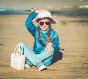 Little girl in a hat on the  beach Royalty Free Stock Images